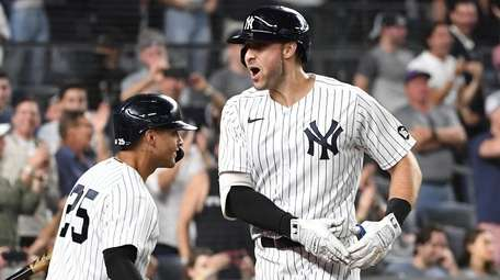 The Yankees' Joey Gallo celebrates with Gleyber Torres