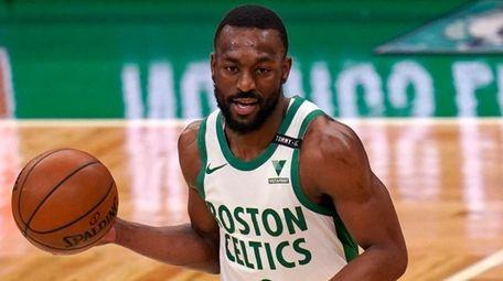 Celtics guard Kemba Walker dribbles the ball during