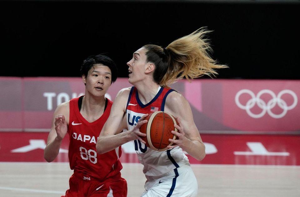 United States' Breanna Stewart (10) drives past Japan's