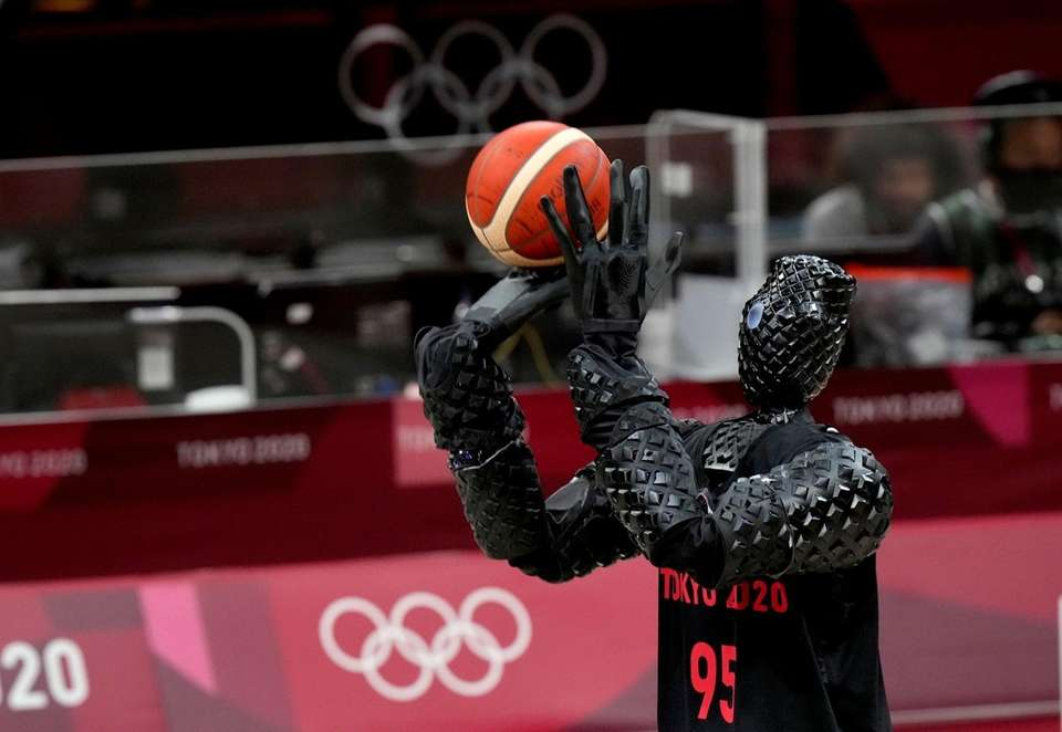 A robot holds the ball during women's basketball