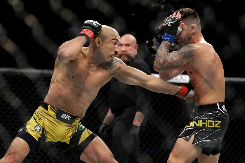 Jose Aldo, left, lands a punch to the
