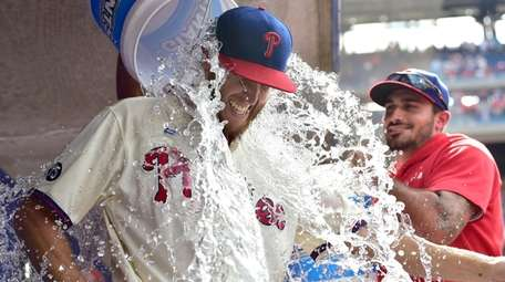 Philadelphia Phillies starting pitcher Zack Wheeler is doused