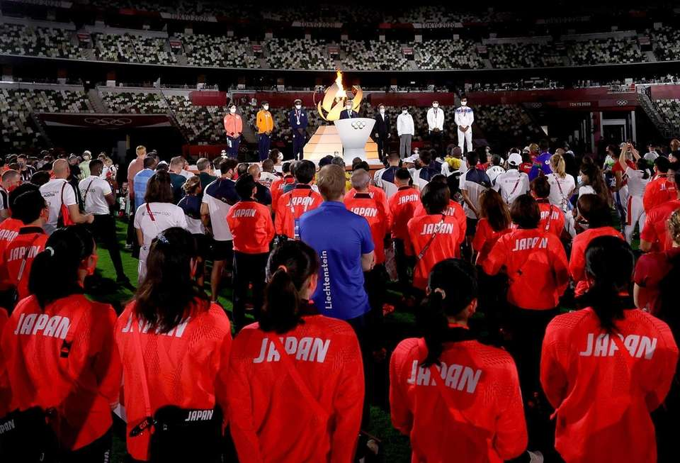Athletes look on as President of the International