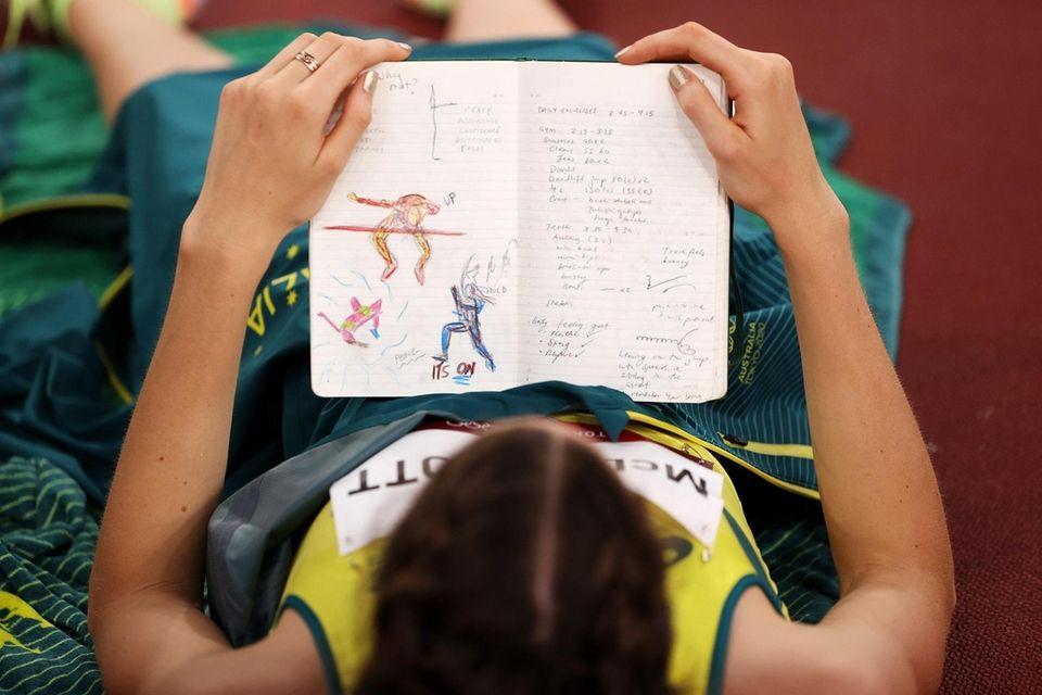 Nicola McDermott of Team Australia reads her journal
