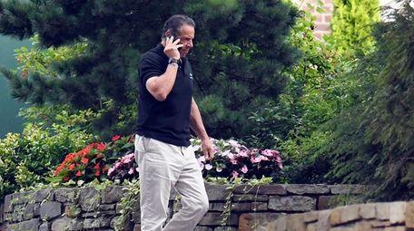 Gov. Andrew M. Cuomo talks on the phone