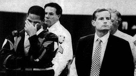 Christopher Ellis, left, with his lawyer, Dennis Lemke,