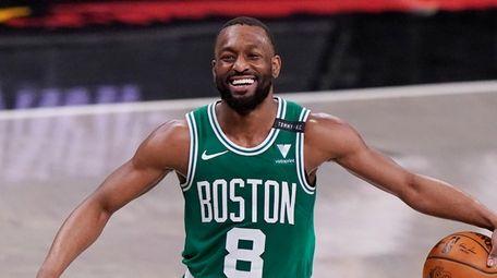 Celtics guard Kemba Walker laughs as he takes