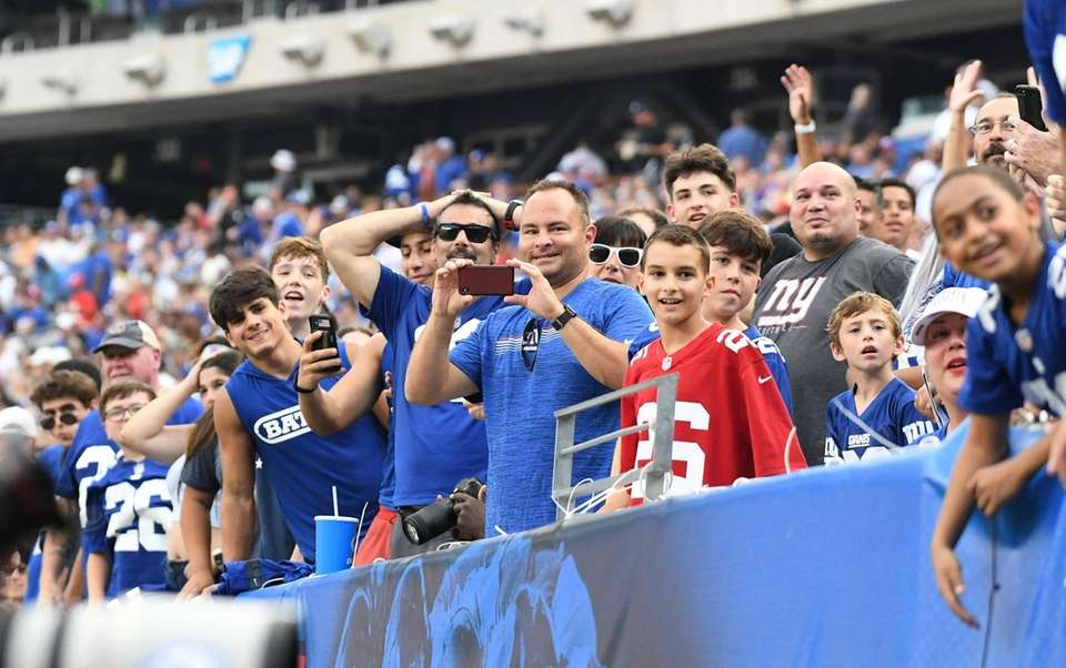 Giants fans watch practice from the stands during
