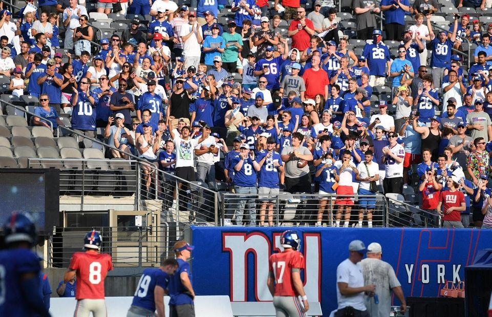 New York Giants fans watch quarterback Daniel Jones
