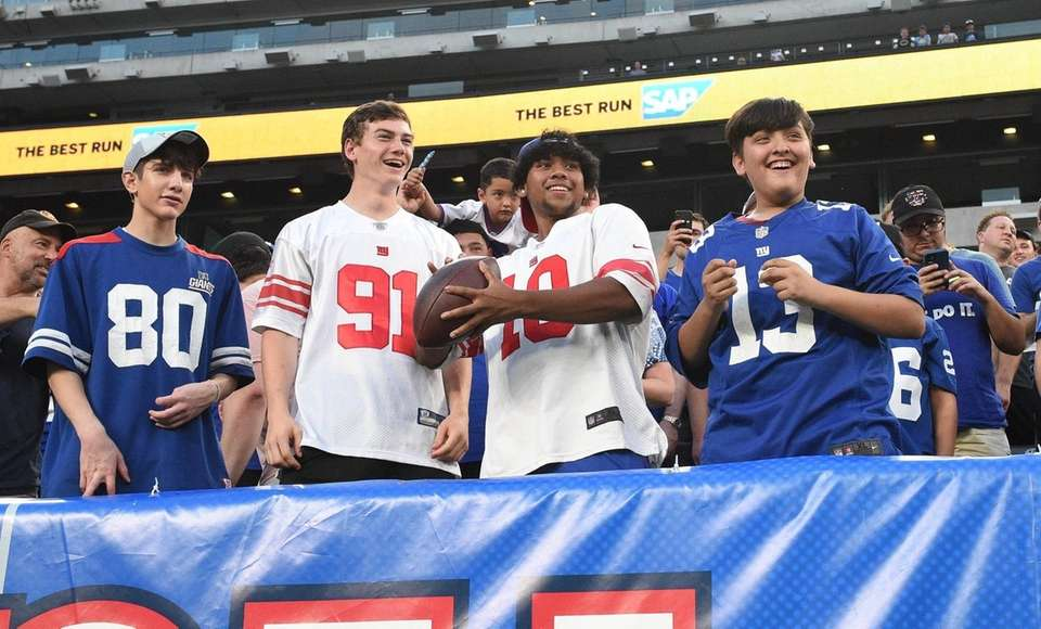 New York Giants fans in the stands toss