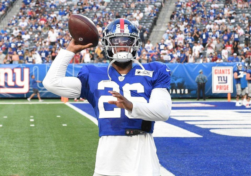 New York Giants running back Saquon Barkley tosses