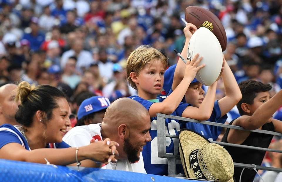 New York Giants fans in the stands hope
