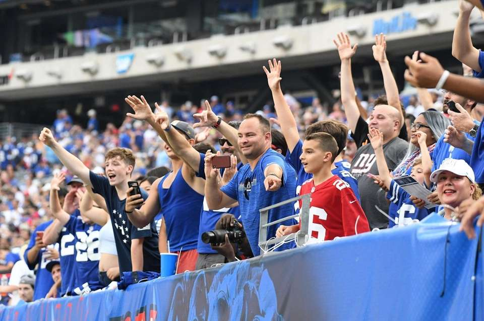 New York Giants fan cheer in the stands