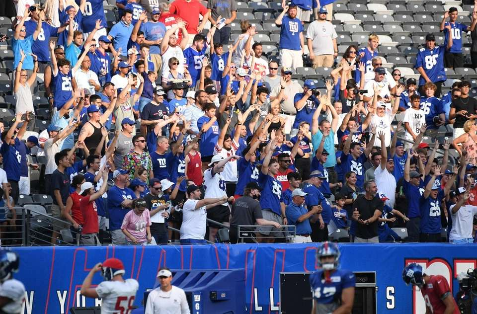 New York Giants fans in the stands wave