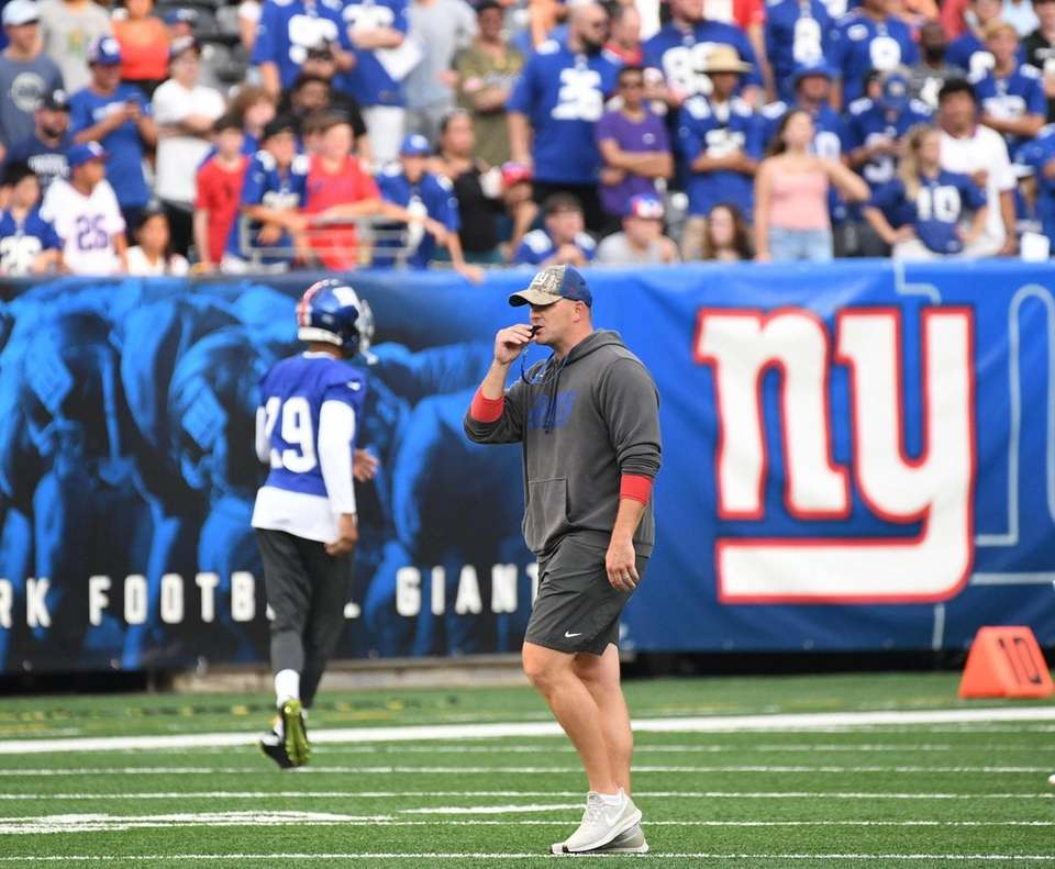 New York Giants head coach Joe Judge walks