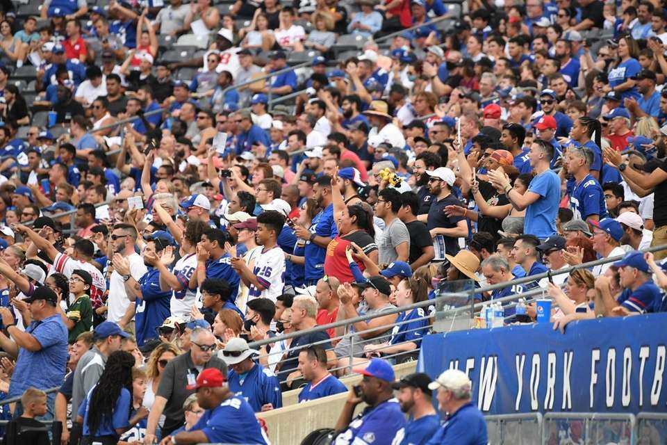 New York Giants fans in the stands watch