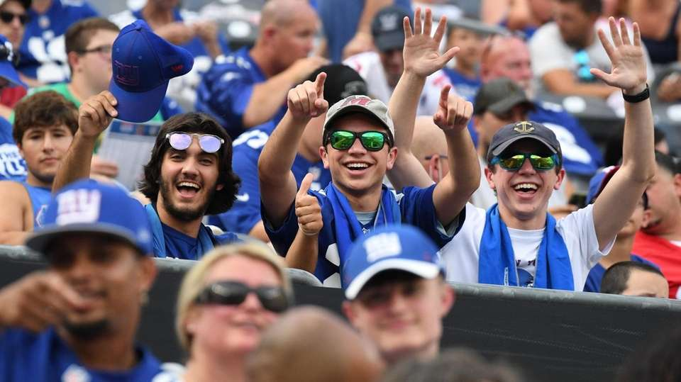 Fans cheer in the stands during Giants Training
