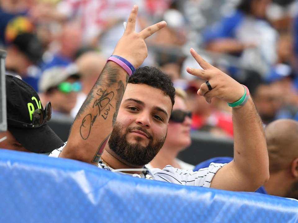 A fan gestures from the stands during Giants