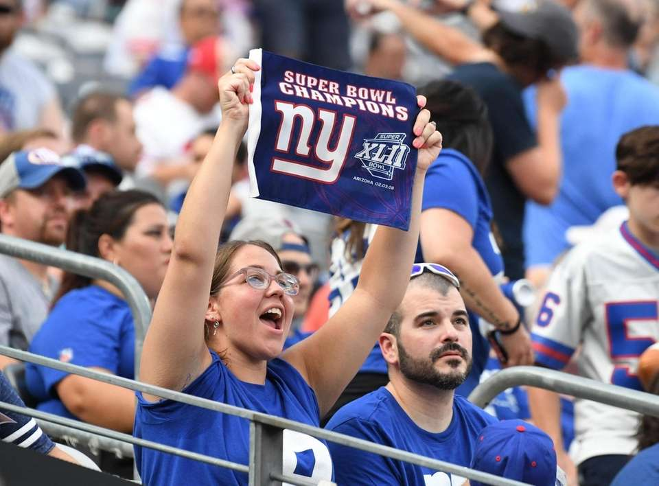 A New York Giants fan holds a banner