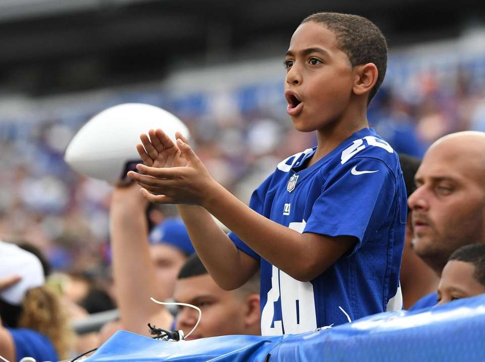 A New York Giants fan cheers in the