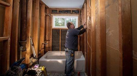 Hogan Construction's Jim Fitzgerald prepairs a wood frame