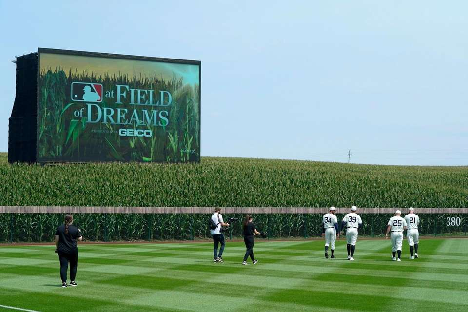Chicago White Sox players walk on the field