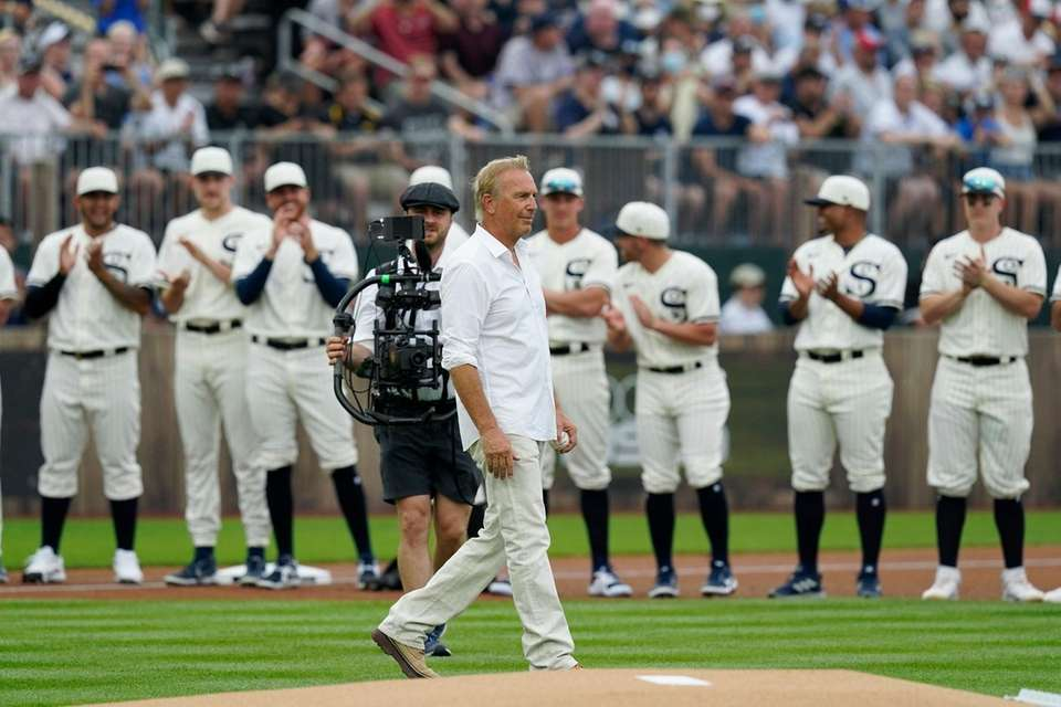 Actor Kevin Costner walks to the stands before