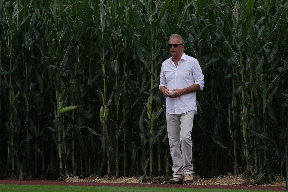 Actor Kevin Costner walks onto the field prior