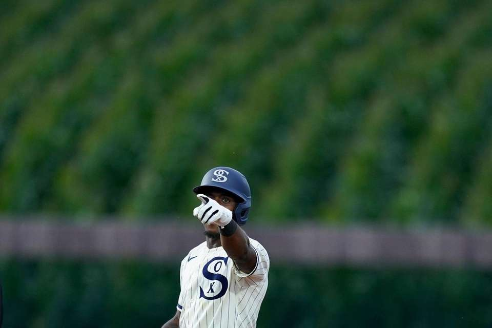 Chicago White's Tim Anderson points to the dugout