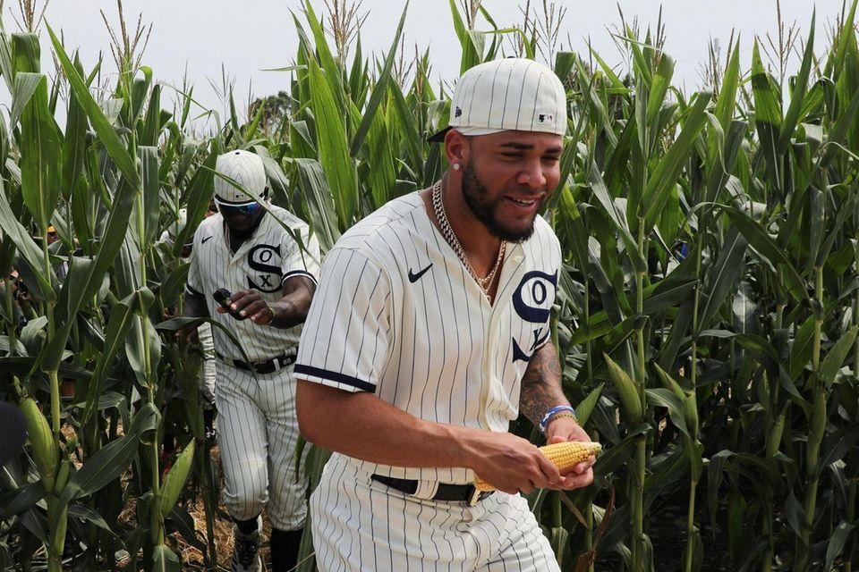 White Sox third baseman Yoan Moncada, right, holds