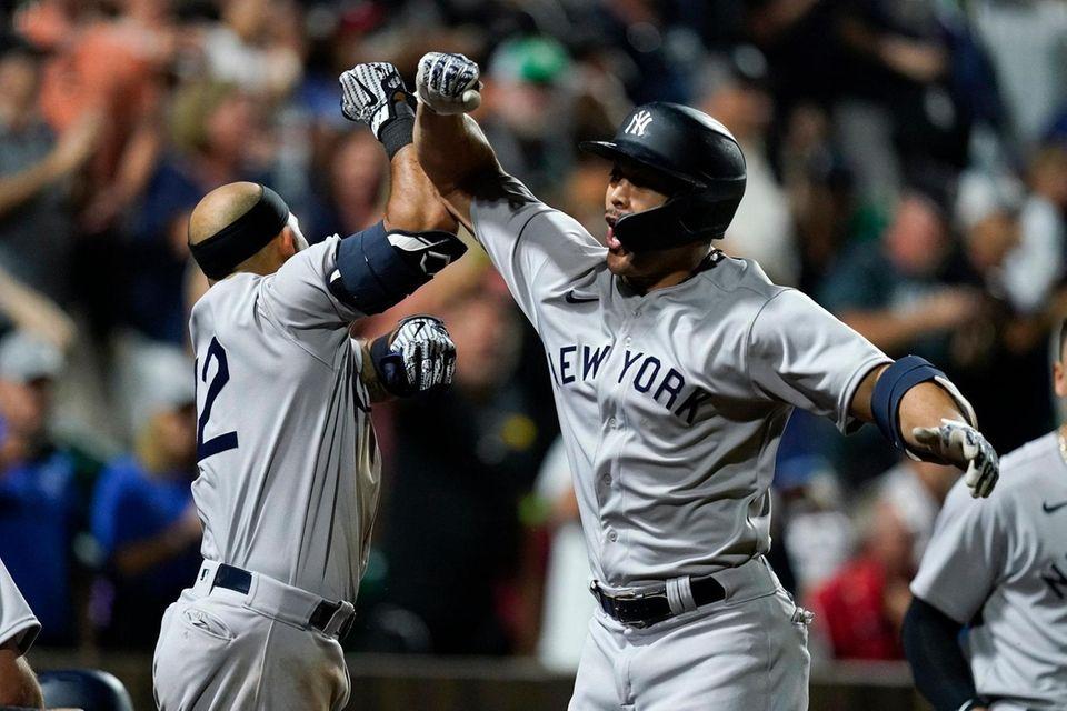 New York Yankees' Giancarlo Stanton celebrates with Rougned