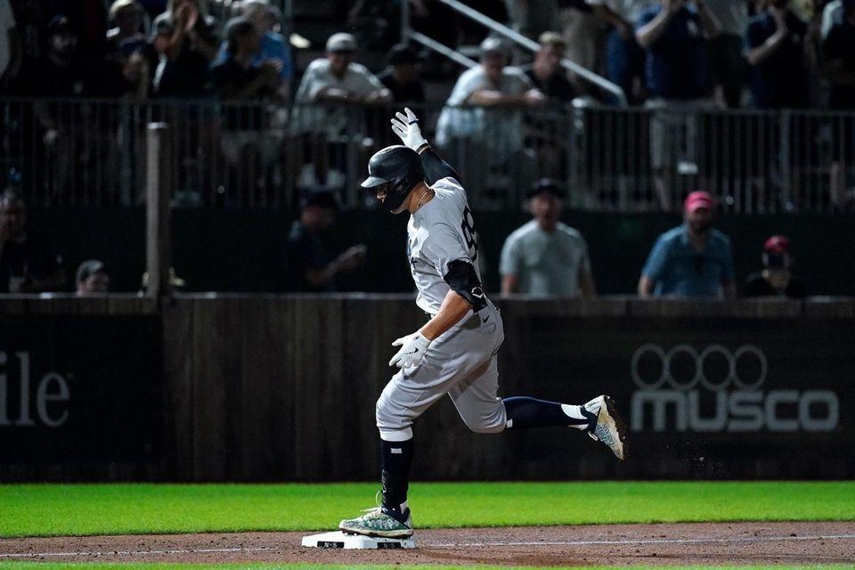 New York Yankees' Aaron Judge rounds third base