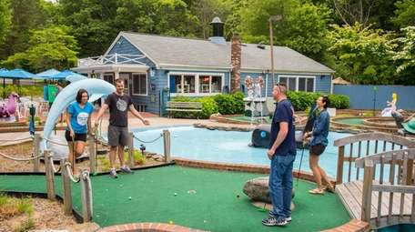 Visitors play the course at the Whale's Tale
