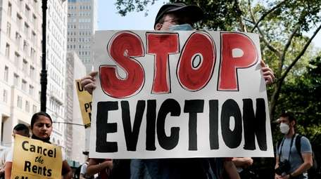 Activists hold a protest against evictions near City