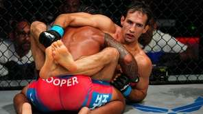 Ray Cooper III and Rory MacDonald in a