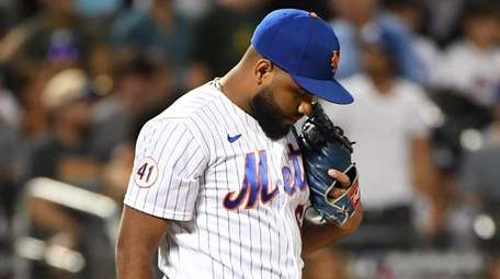 Mets relief pitcher Yennsy Diaz stands on the