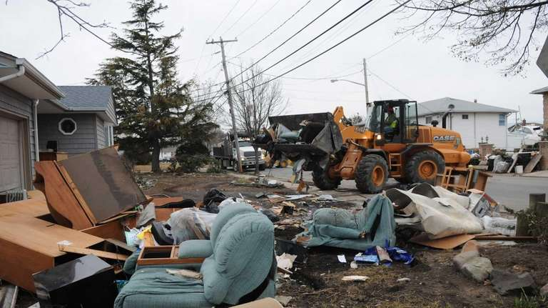 Debris picked up in front of a home