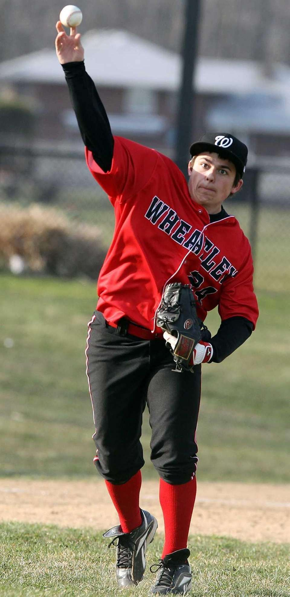 Wheatley's Andrew Feimee throws to first for the