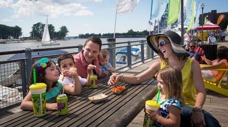 A family enjoys the day at Buffalo's Canalside.
