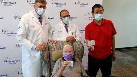 Two cancer patients on Tuesday received athird dose
