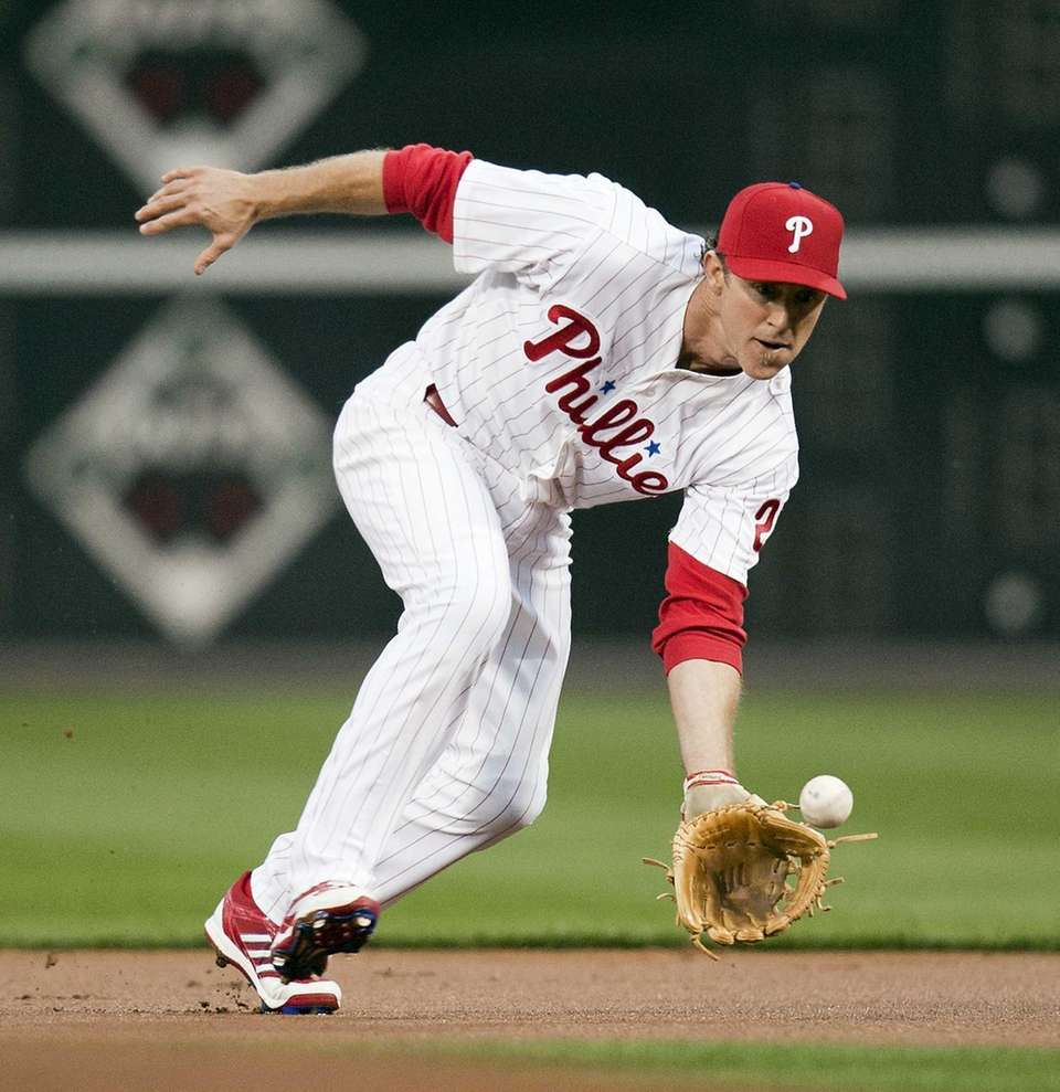 Philadelphia Phillies second baseman Chase Utley fields a