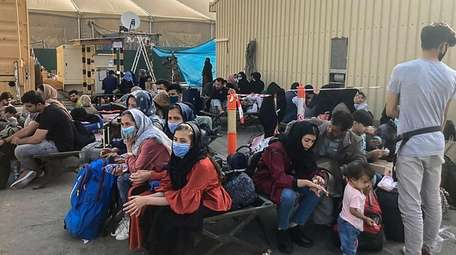 People wait to be evacuated from Afghanistan on