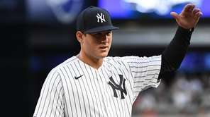 Yankees first baseman Anthony Rizzo gestures from the