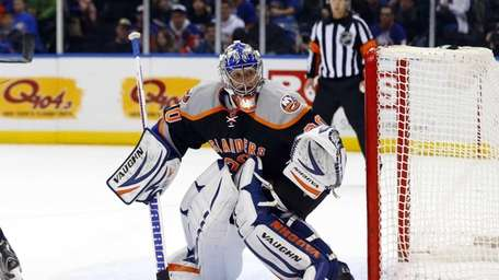 Evgeni Nabokov defends the net during a game