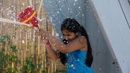 Anubha Saha from Queens plays wild water balloon