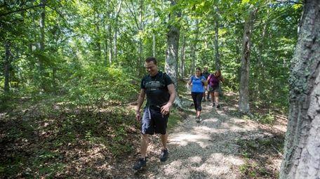 Friends hike at Mashomack Preserve in Shelter Island.