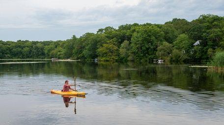 Ken Morse kayaks near his home on Big
