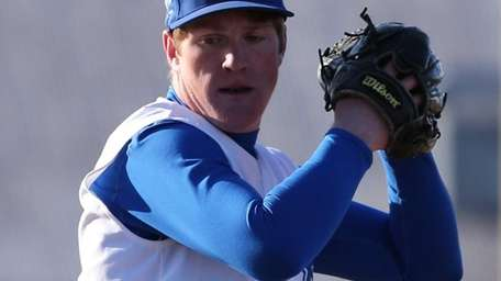 Riverhead's Matt Crohan delivers a pitch in his