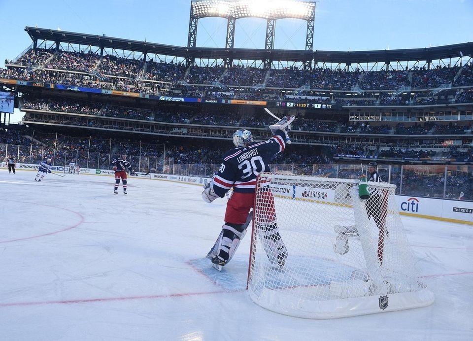 New York Rangers goaltender Henrik Lundqvist deflects the