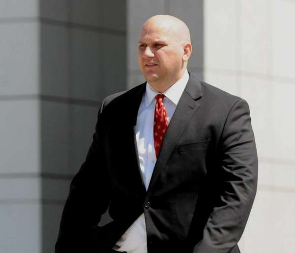 Michael Figat, 35, of Shirley, leaves federal court